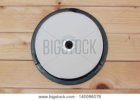 CD drives on wooden background retro disk