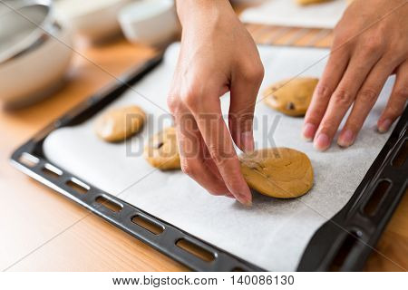 Putting dough in metal tray