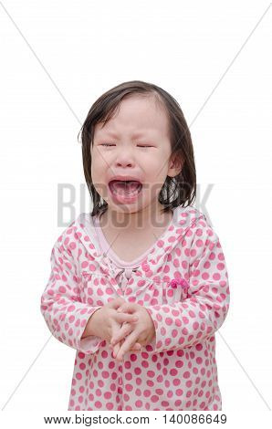 Little Asian girl crying isolated over white
