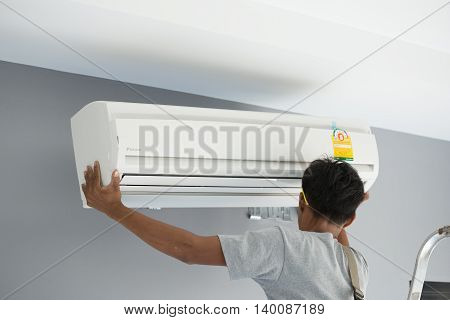 Worker Installing Air Conditioning