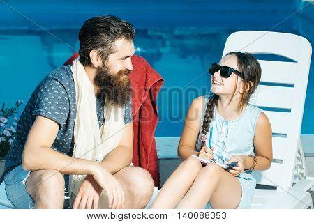 Happy Small Girl And Man At Swimming Pool