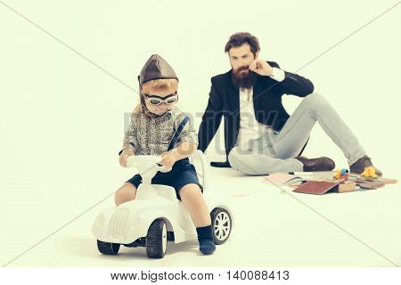 Small Boy Driver Or Pilot And Bearded Father
