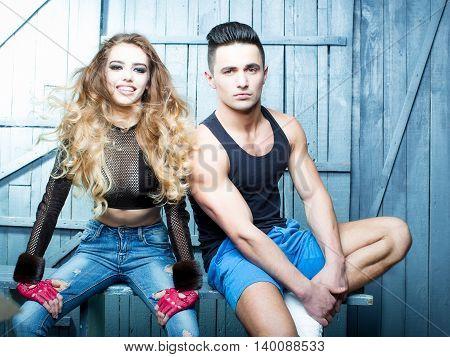Stylish couple. Shot of a fashionable couple posing at studio