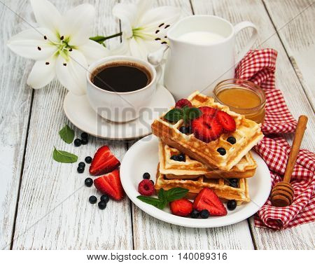Waffles With Strawberries,  Blueberry And Coffee