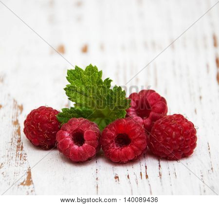 fresh raspberries on a old wooden background