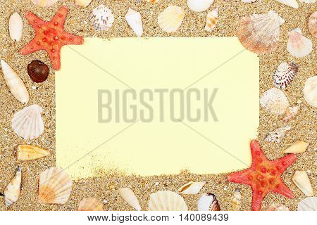 blank paper on sand with shells for messages