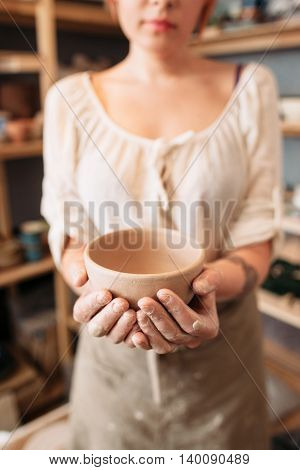 Unrecognizable woman holding empty bowl, void. Picture of industrious person, showing her result of work. Agricultural advertisement idea