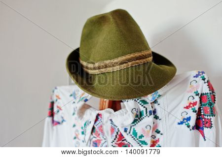 Old Olive Linen Hat On A Mannequin With Traditional Clothes