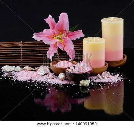 Spa feeling with lily, candle .pile of salt