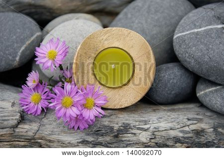 Candle with stones ,flower on old background