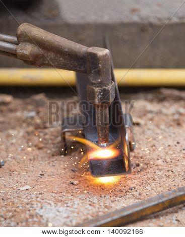 Worker Drilling Steel Plate