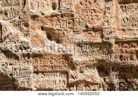SIGULDA LATVIA - JULY 16 2016: Old inscriptions in the Gautmanis Cave located on the Gauja River