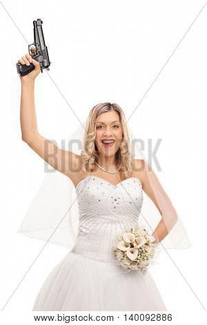 Vertical shot of an excited young bride holding a gun in one hand and a bouquet of flowers in the other isolated on white background