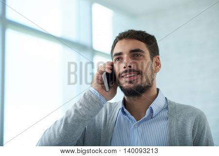 Portrait of handsome businessman talking on the phone