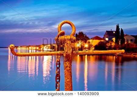 Rusty anchor view at blue evening by the sea Zadar Croatia