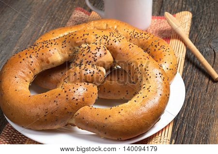 Sweet pretzels with coffee cup for breakfast on bamboo napkin