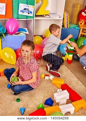 Two children game blocks on floor in primary school. Children class in primary school. Top view.