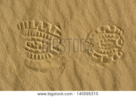 human footprint in the vast expanses of sand