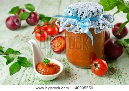 Tomato ketchup sauce with garlic spices and plums. Home canning