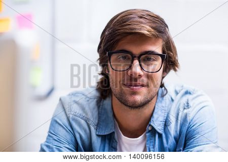 Portrait of young man in creative office