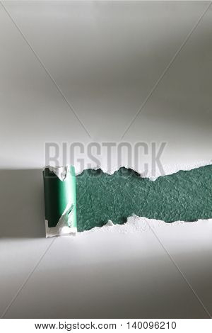 ripped white cardboard on top of blackboard