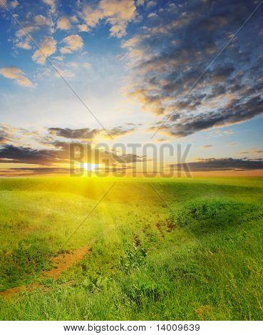 Sunset under rural landscape