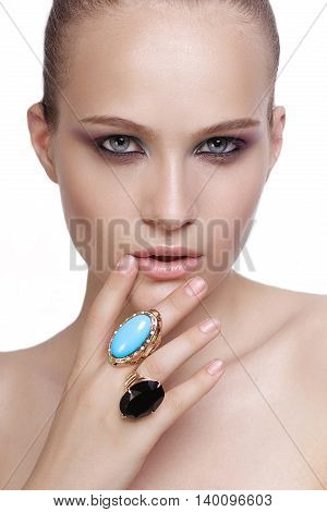 Beautiful model with evening make-up. Jewelry and Beauty. Fashion photo