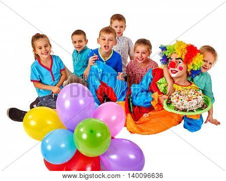 Clown keeps bunch of balloons and birthday cake with group children. Birthday celebration. Isolated.
