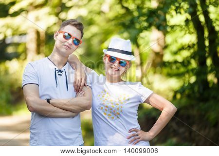 Happy hugging couple in a park at summer time