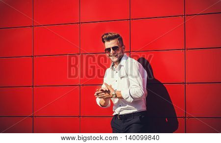 Portrait of a successful man on a red background