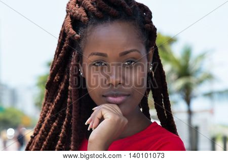 Sensual african woman with dreadlocks outdoor in city in summer