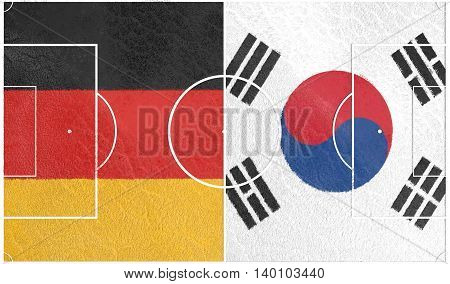 Flags of countries participating to the football tournament. Football field textured by Germany and Korea national flags.3D rendering