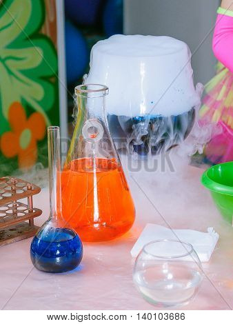 Chemical liquid in chemical flasks.  Laboratory equipment. Cryo show.