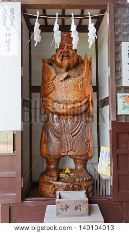 AKO JAPAN - JULY 18 2016: Statue of Ebisu in the Oishi Shrine on the grounds of Ako Castle Japan. Ebisu is the god of prosperity and wealth in business one of Seven Gods of Fortune