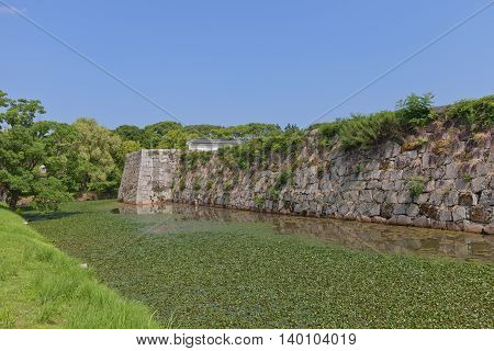 AKO JAPAN - JULY 18 2016: Stone walls and moat of the main bailey (Honmaru) of Ako Castle (circa 17th c.) in Ako Japan. Castle was a seat of Lord Asano Naganao