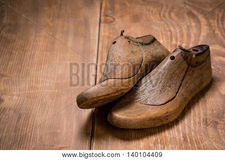 Shoe Lasts on the wooden background. Retro style