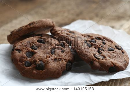 Cookies With Chocolate Chip On Parchment Paper Napkin On Wooden Table.