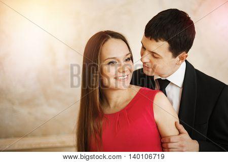Headshot Of Elegant Couple Embracing And Kissing