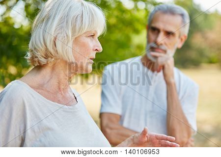 Senior couple in summer in the nature on a date