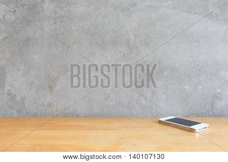 Cement wall background and smart phone .