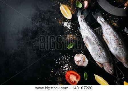 Top view of fish with vegetables and spices. Cooking or healthy concept with copy space