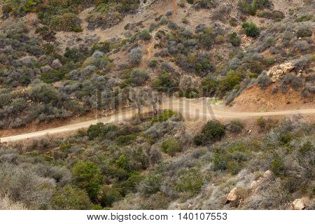 Dirt road through San Fernando valley in California, USA