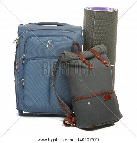 The suitcases, karrimat on white background. The travel, tourism and holidays concept