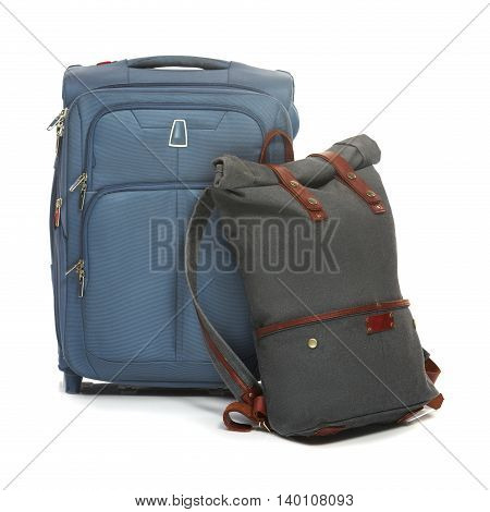 The suitcases on white background. The travel, tourism and holidays concept