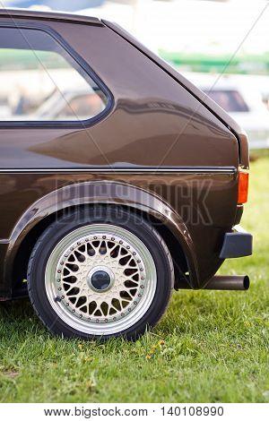 Left rear side of old european brown car.