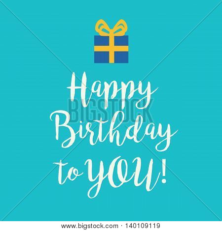 Cute Happy Birthday to You greeting card with a handwritten text and a blue wrapped birthday gift with yellow ribbon bow on a turquoise blue background.