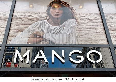 LONDON UK - JULY 1 2014: Mango Fashion store exterior view in Oxford Street. Mango is an international clothing design retail chain with 10000 employees 2300 stores in 107 countries worldwide.