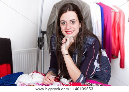 Fashion designer working on her designs in the studio
