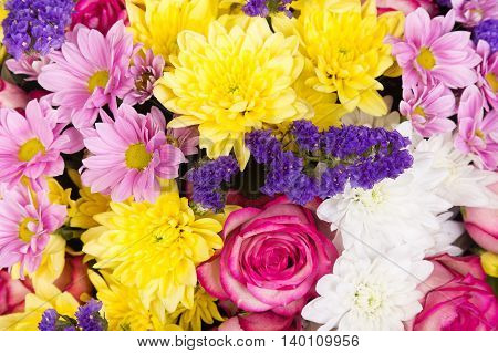 Colorful flower background of roses chrysanthemums and limonium
