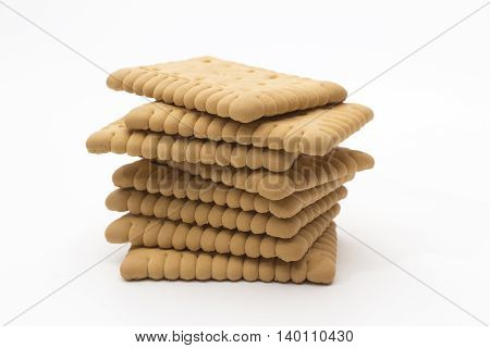 Pile biscuits arranged on a white background